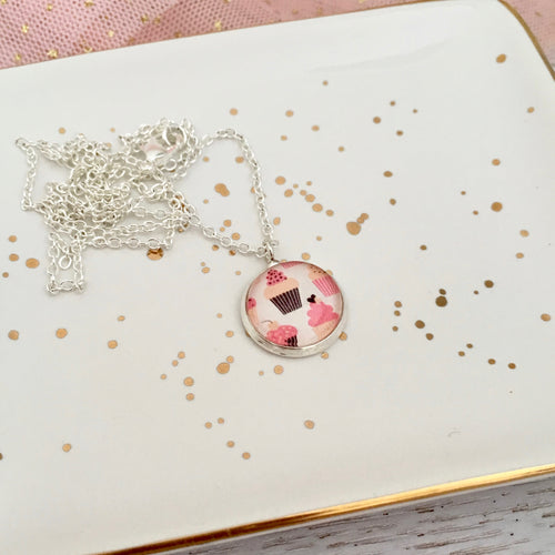 Girls glass dome pendant necklace with pink cupcakes on a silver chain