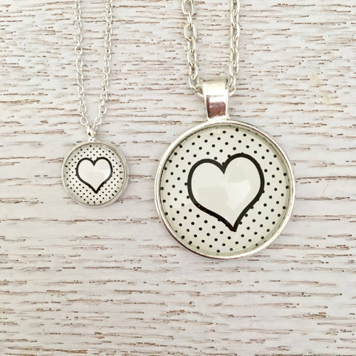 Matching Mummy and daughter glass dome pendant necklace with link chain, monochrome hearts
