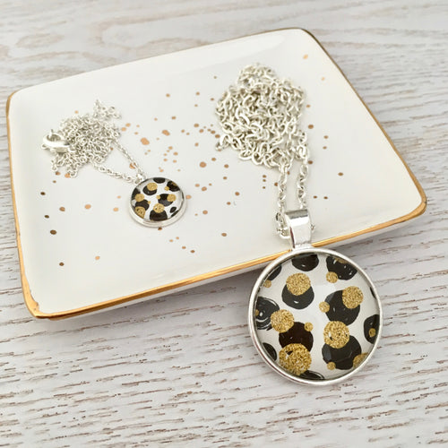 Matching Mummy and daughter glass dome pendant necklace with link chain, black and gold spots