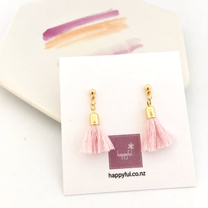 Mini pink cotton tassel earrings on gold plated ball stud