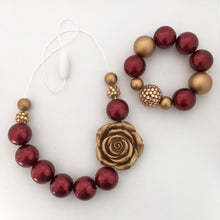 Girls red and gold Christmas bead necklace and bracelet set