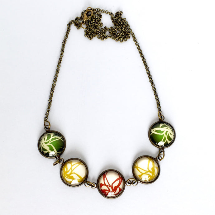 Green, red and yellow flame glass dome necklace on bronze chain