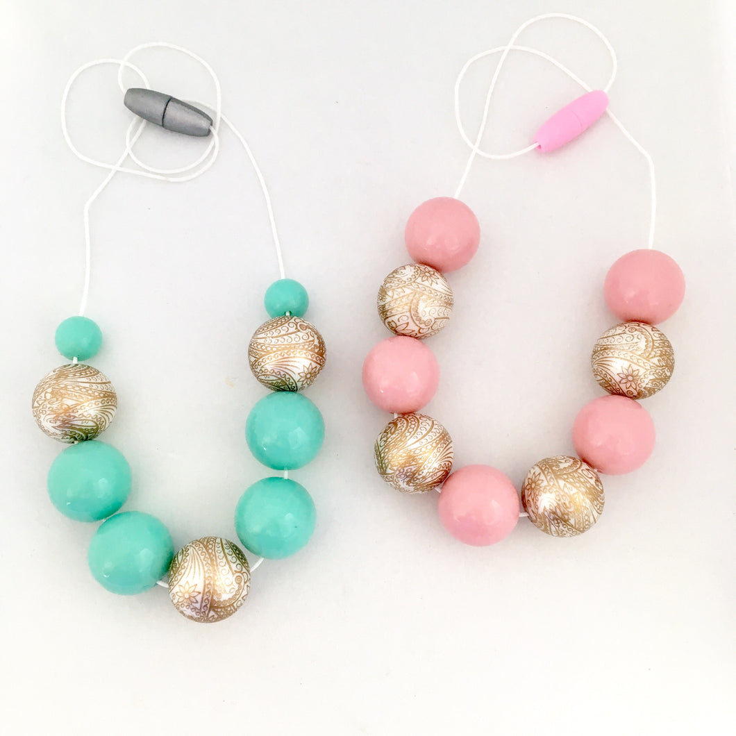 Girls mint and pink bead necklaces