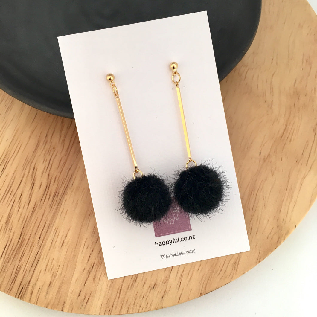 Black pompom earrings with gold posts from Happyful Nz