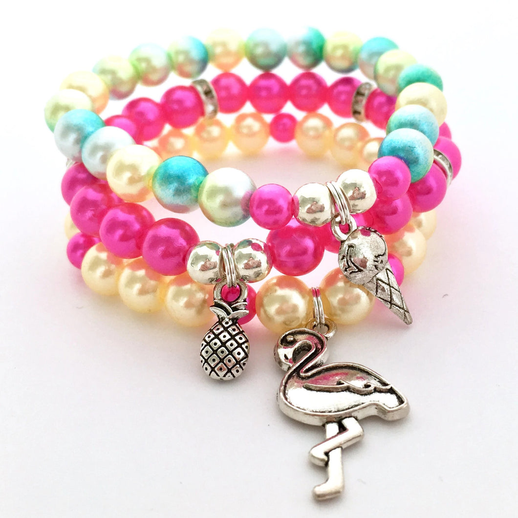 Girls pink and yellow tropical charm stack bracelet with flamingo, pineapple and icecream charms