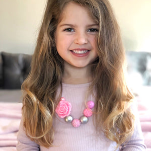 Girl wearing pink and silver bubblegum bead necklace from Happyful NZ