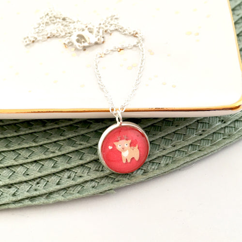 Girls red reindeer pendant necklace on a silver link chain