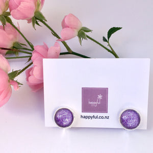 Purple bird clip on earrings