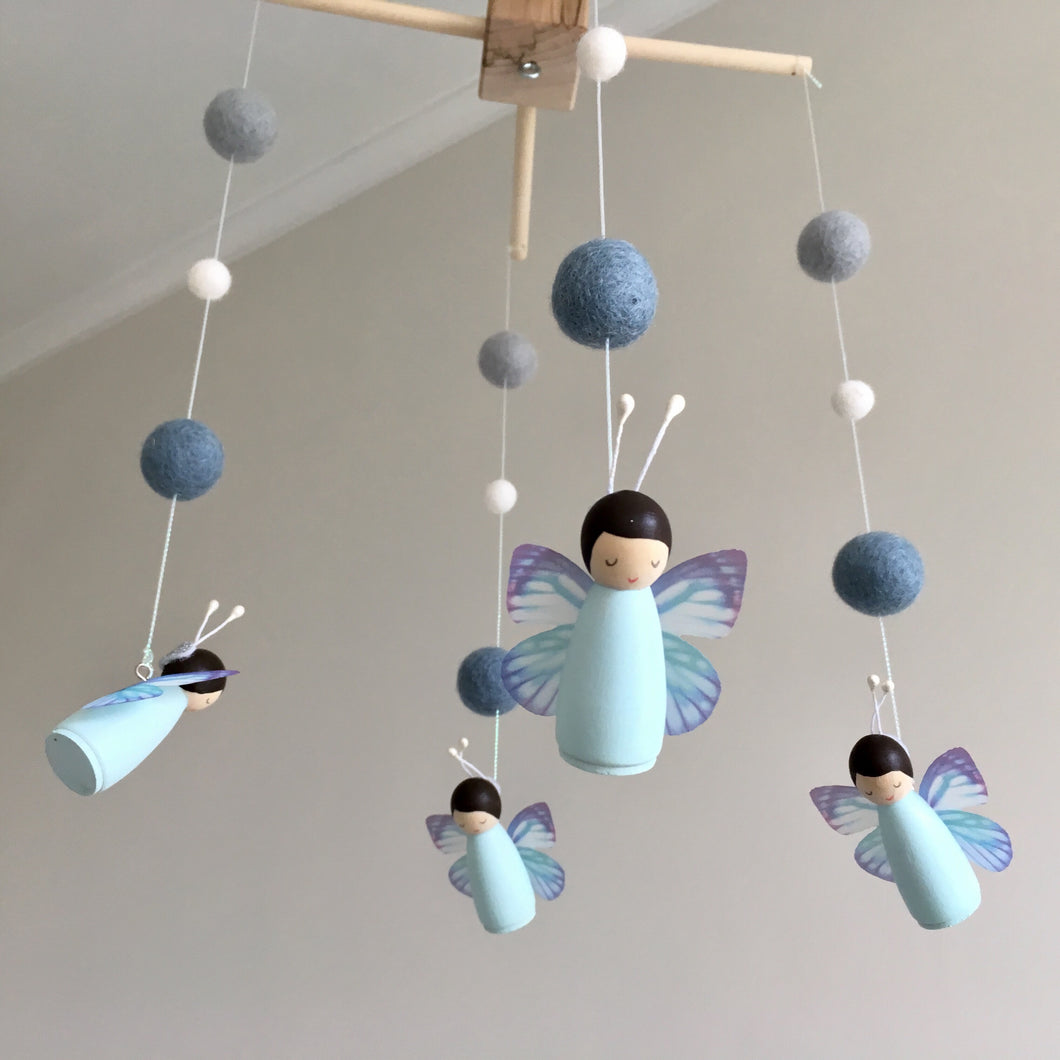 Teal and grey fairy peg doll mobile with felt balls and wooden hanger for nursery or baby room