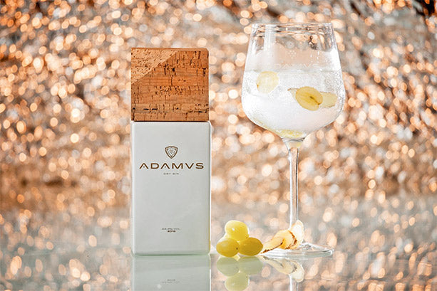 Adamus bottle and glass