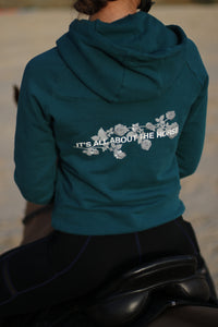 'IT'S ALL ABOUT THE HORSE' hoodie in Peacock