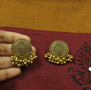 Gold oxidized ghungroo stud earrings