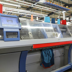 tullibee knitted blanket being knitted on stoll knitting machine