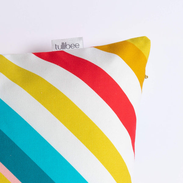 close up of tullibee brand label on side of milo retro diagonal varying width stripe cushion