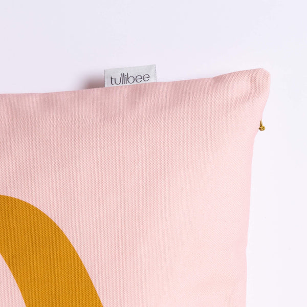 close up of tullibee brand label on side of margot in the middle large retro floral cushion