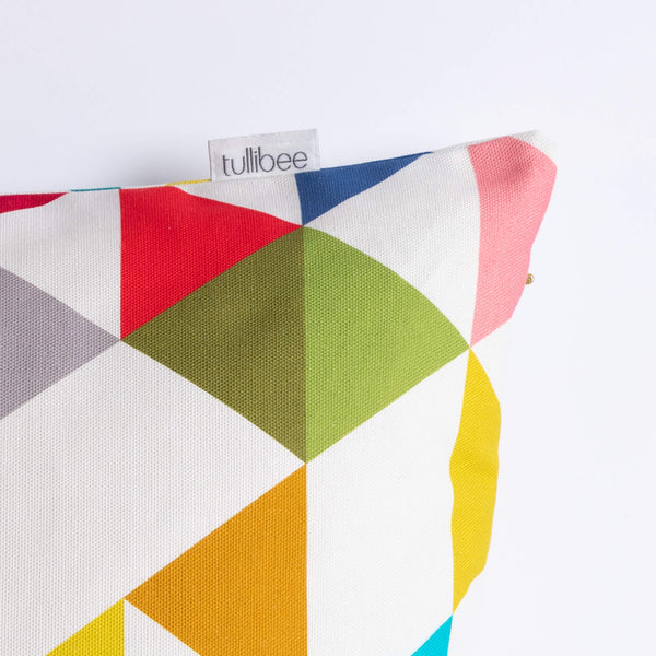close up of tullibee brand label on side of Yoshi rainbow triangle cushion