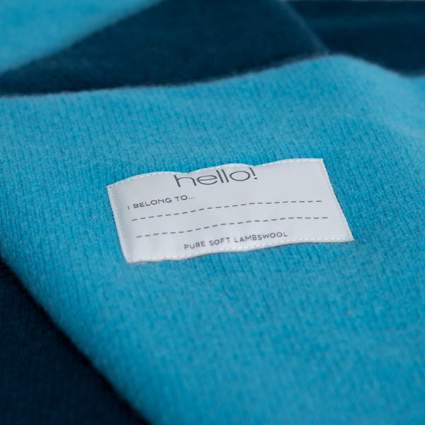 tullibee knitted blanket WOW blue hello label close up