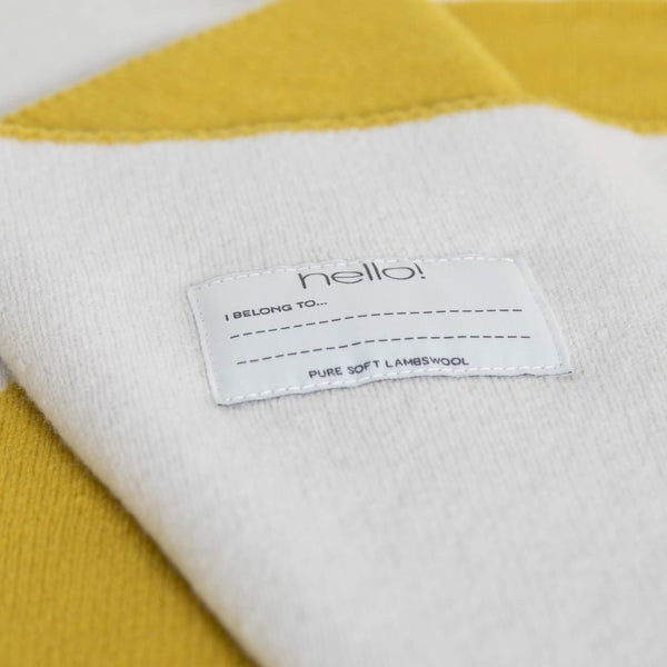 tullibee knitted blanket WOW mustard hello label close up