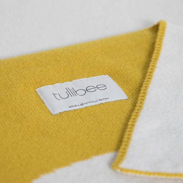 tullibee knitted blanket WOW mustard brand label close up