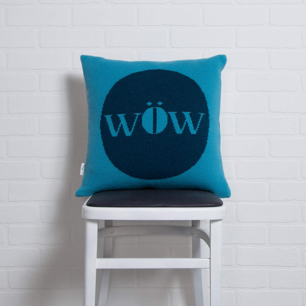 tullibee knitted cushion WOW blue on chair