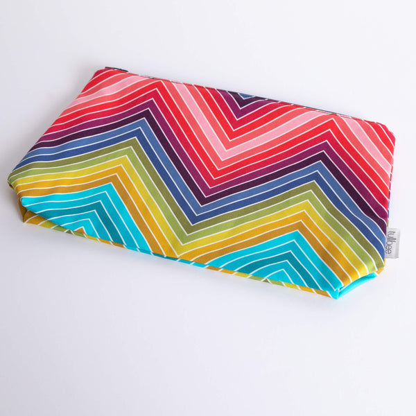 tullibee marni rainbow zig-zag maxi pouch flat at an angle on a white surface