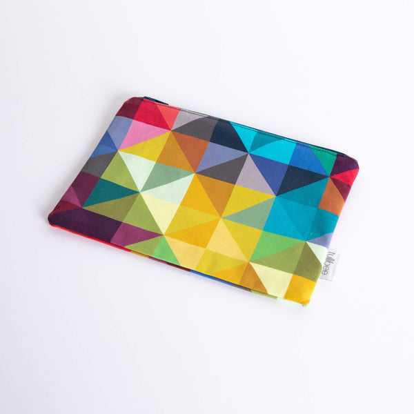 tullibee jules rainbow geometric triangle midi rectangular pouch at an angle flat on a white surface