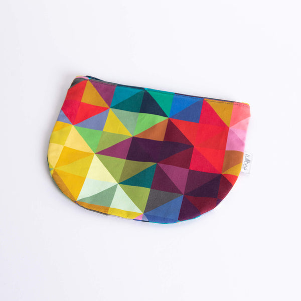 tullibee jules rainbow geometric triangle midi round pouch at an angle flat on a white surface