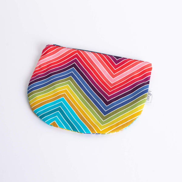 tullibee marni rainbow zig-zag midi round pouch at an angle flat on a white surface