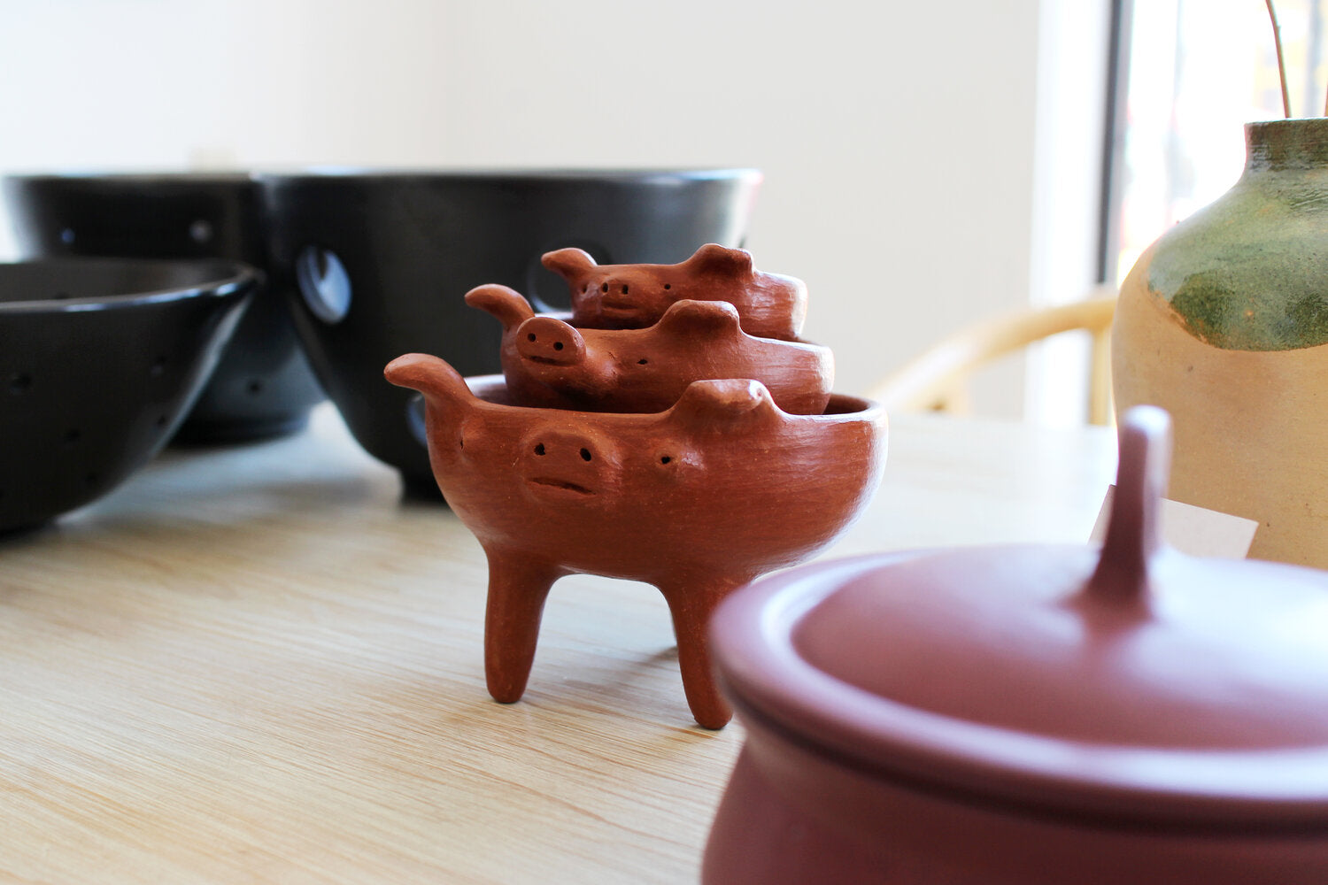 Little Pig bowl made from red clay by hand in Oaxaca Mexico