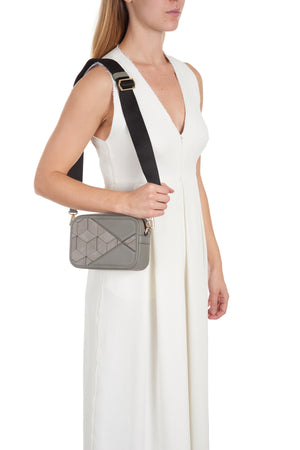 rove belt bag (stone) on model shoulder
