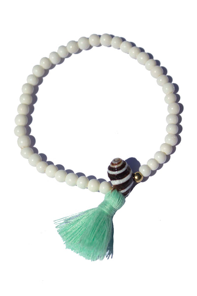Beaded Bracelet with White Bone Beads, Pyrene Shell and Tassel
