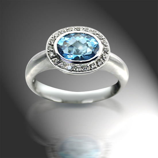 Oval Blue Topaz Ring with Diamonds