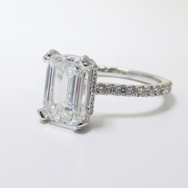 emerald cut diamond cathedral setting