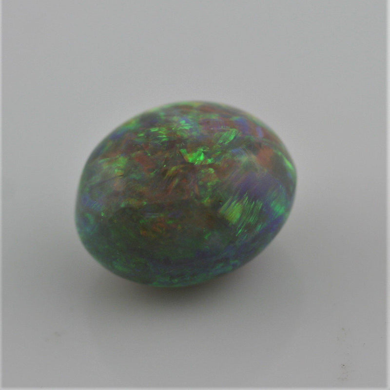 5.38 carat Australian Dark Opal Cabochon Play of color Orange Green Blue - Thenetjeweler