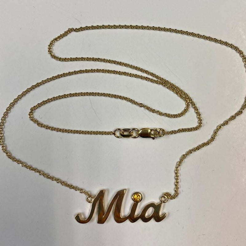 "This Name Necklace Mia Citrine Accent Yellow Gold can be set with a birthstone, the natural gemstone of your choice. The name necklace is custom made to order and comes with a matching chain 16"" long."