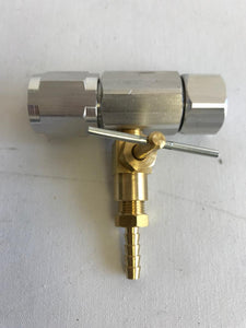 An image of a Tri-Con pressure booster spray head with an attached reversible nozzle.