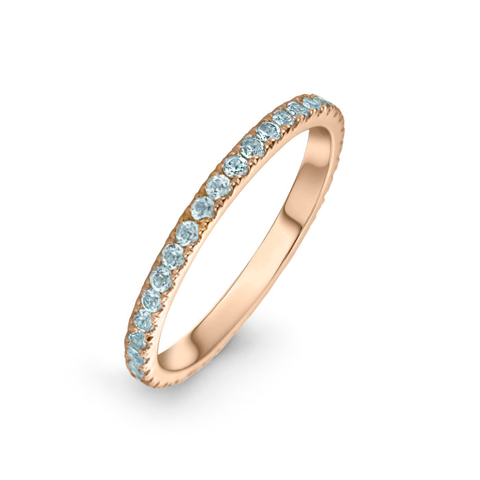 lafia straight and narrow channel set blue topaz eternity ring 14 karat rose gold