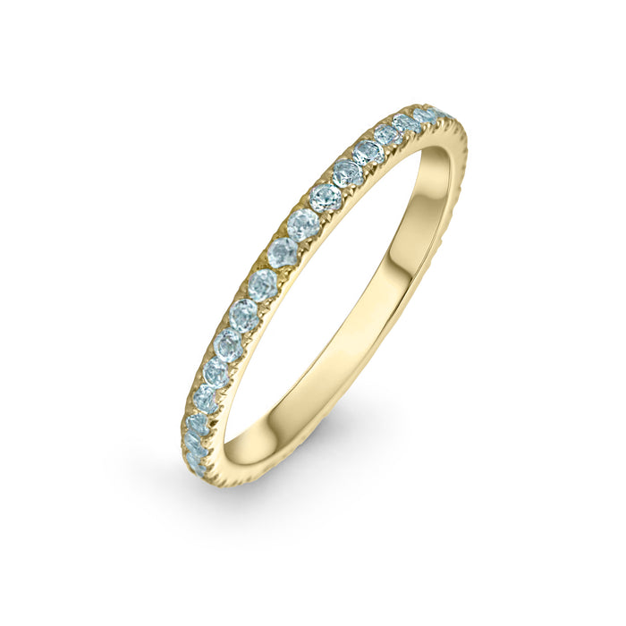 lafia straight and and narrow channel set blue topaz eternity ring 14 karat yellow gold