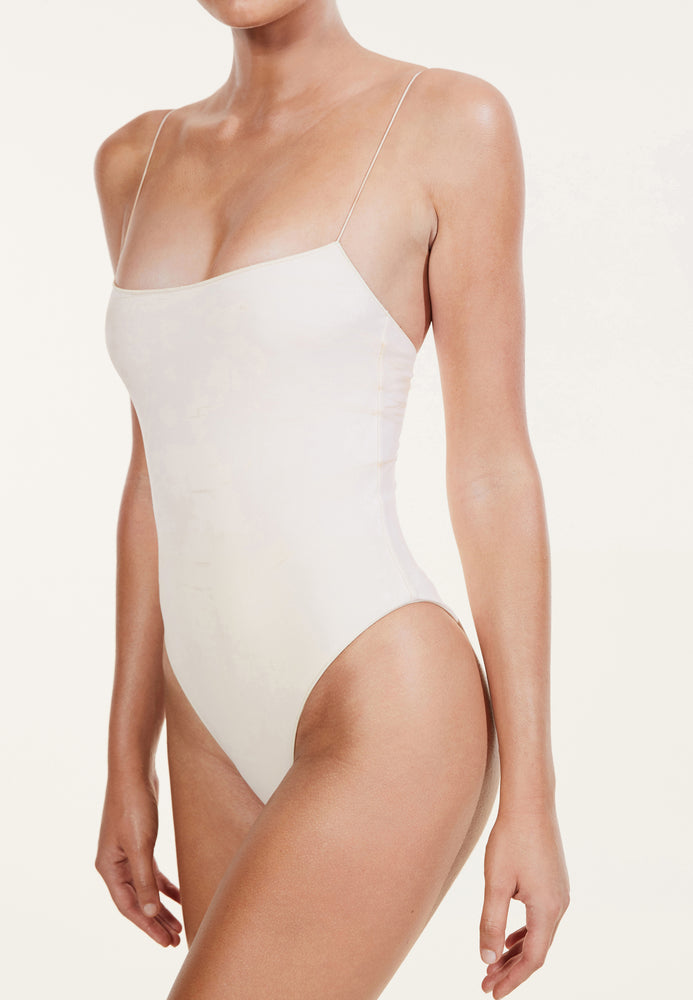 swimwear-the-C-one-piece-bodysuit-low-scoop-neckline-skinny-elastic-straps-high-cut-sustainable-fabric-eco-beige-color