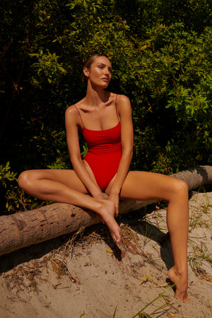 swimwear-the-C-one-piece-bodysuit-low-scoop-neckline-skinny-elastic-straps-high-cut-sustainable-fabric-eco-red-poppy-color