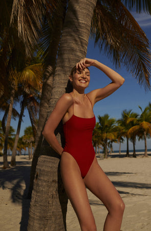 swimwear-the-C-one-piece-bodysuit-low-scoop-neckline-skinny-elastic-straps-high-cut-sustainable-fabric-eco-red-hibiscus-color