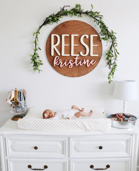 Large Wood round name sign with greenery 24