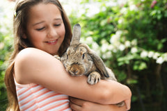 girl hugging a rabbit