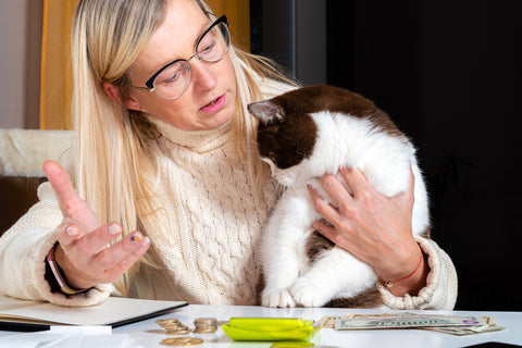 woman talking to her cat
