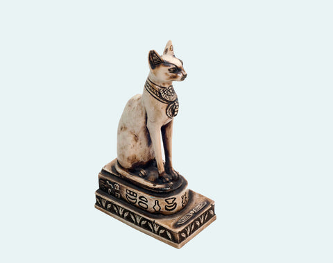 Egyptian statue of a cat with a primordial belly