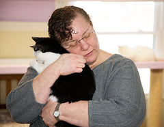 Dawn holding Minnie, a Neady Cats shelter resident