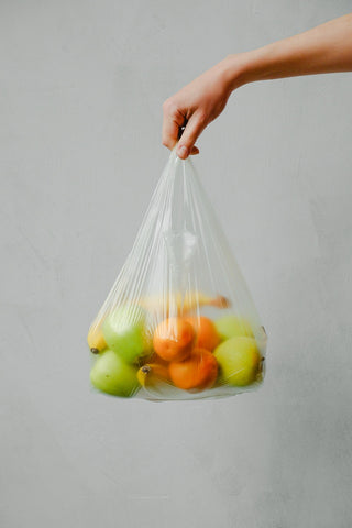 plastic grocery bag with fruits
