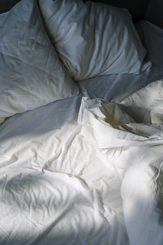bed with covers rumpled
