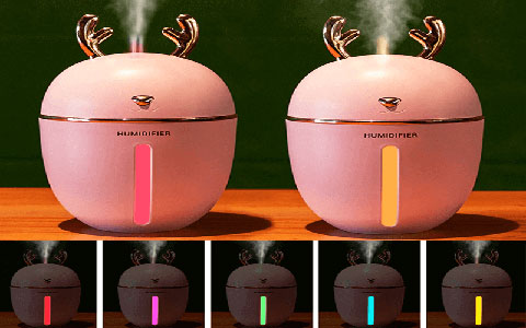 Pink Ava Home humidifiers on wooden desk with all led colors displayed