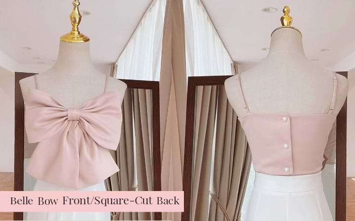 Front and back images of the pink Belle Bow Camisole Crop Top showing the dramatic flair of the bow in front, and the straight line square-cut back, pair with white bottoms